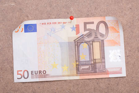 Banknote pinned on a board Stock Photo