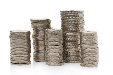Stacks of coins on a white table Stock Photo
