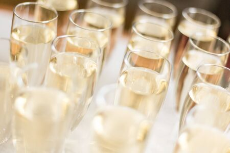 Champagne glasses on a white table cloth
