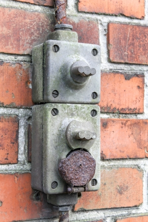Old outdoor electric wall plug with on off switch