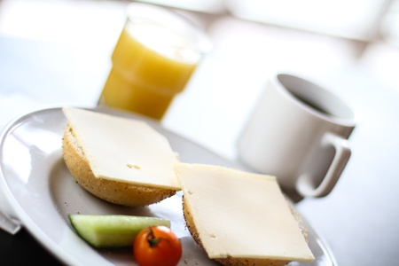 Breakfast with plate of bread and cheese
