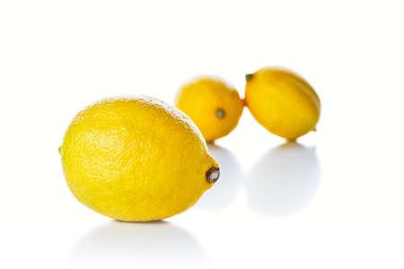 Closeup of lemon on a white reflective surface