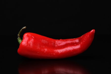 Red Pepper on a reflective surface Stock Photo