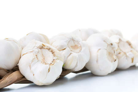 Closeup of garlics on a white table