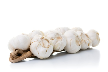 Bundle of garlics laying on a white table