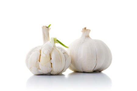 Two garlic onions isolated on white with shadow
