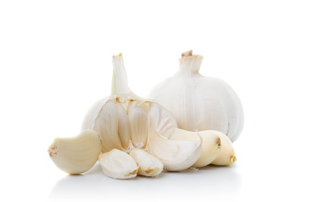 one peeled, one whole garlic onions isolated on white
