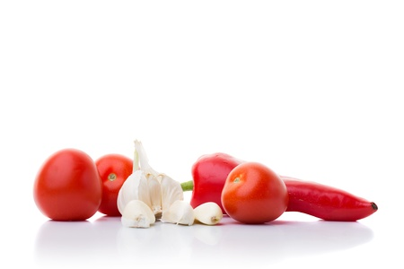 Line of garlic, tomato and red pepper isolated on white