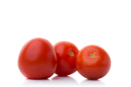 Three tomatos isolated on white with shadow