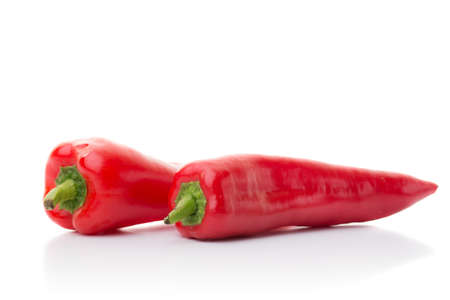 two red pepper isolated on white with shadow