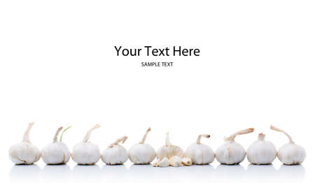 Line of garlic onions with space above for text Stock Photo