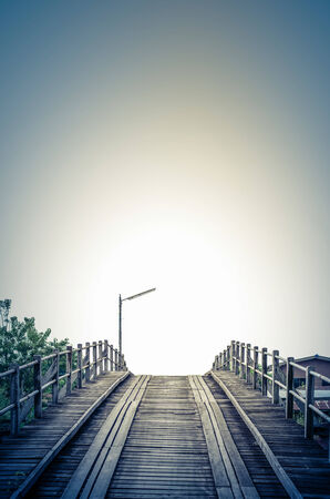 Vintage blue style,An old bridge made from timber in thailand photo