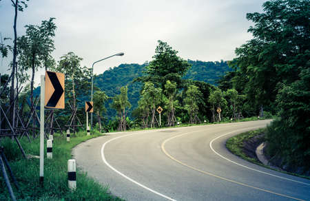 overtake: A traffic warning sign  Curved road  Stock Photo