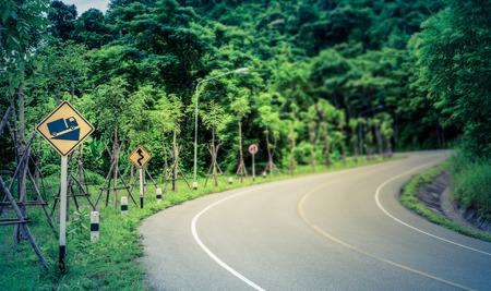 overtake: A traffic warning sign  Steep road