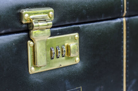 Close up image of a combination lock on leather suitcage and number shown 911 photo