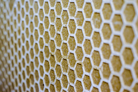 Close up of honeycomb pattern on the wall photo