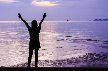 siluet: An image of a girl siluet in violet sunset