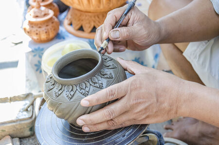 An image of hands of Thai people making clay potery photo