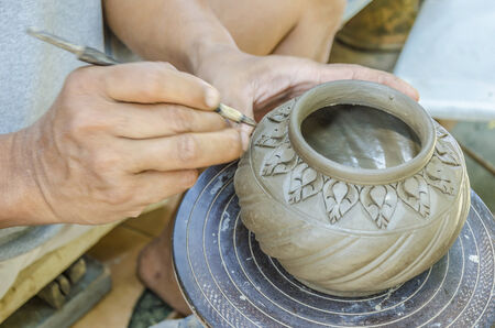 pottery: An image of hands of Thai people making clay potery Stock Photo
