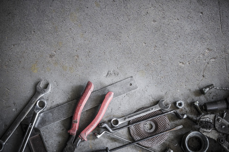 Vintage style image of blank space on concrete floor which have a lot of old tools as props in the scene 免版税图像 - 37591090