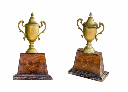 tarnished: Isolated image of an od Trophy mand from brass which have wood as base