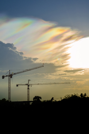 sillouette: Sillouette image of tower crane which have rainbow sky as background