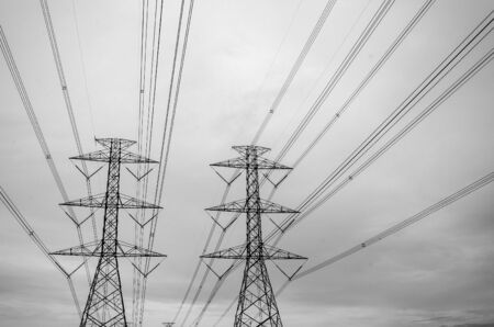 electricity pylon: Black and white image of high voltage electricity pylon