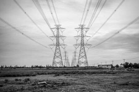 pylon: Black and white image of high voltage electricity pylon