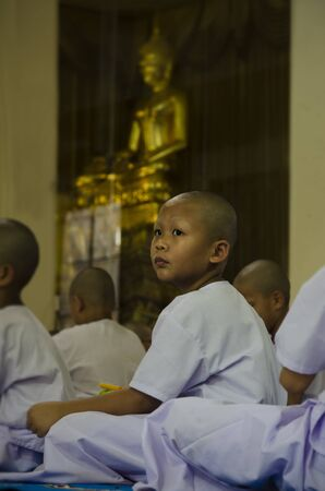 ordain: PATHUMTHANI PROVINCE, THAILAND - March 26 20164 : Buddhist boy waiting for ordination in church  during recess to study the Dhamma in the temple loacted in Lumlukka, Pathumthani, Thailand