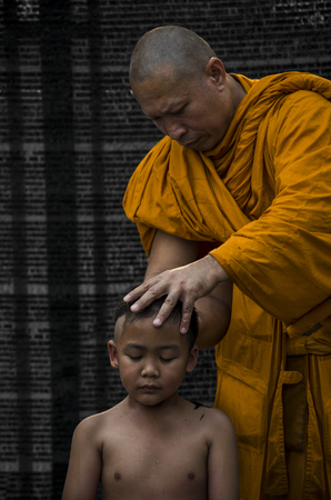 ordain: PATHUMTHANI PROVINCE, THAILAND - March 23 20164 : Buddhist boy Were shaved  by monk. Preparing for ordination during recess to study the Dhamma in the temple loacted in Lumlukka, Pathumthani, Thailand
