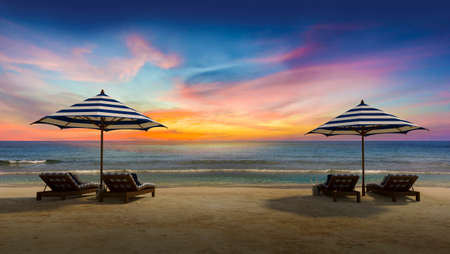 day bed: 3d rendering image of double wooden day bed under the blue and white umbrella on the beach, Sunset time perspective, Twilight time