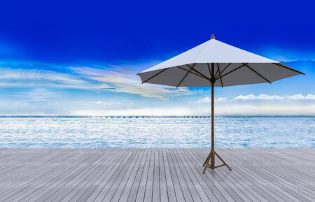 rainbow sky: 3D rendering image of white umbrella on timber terrace which have sea and rainbow sky as background