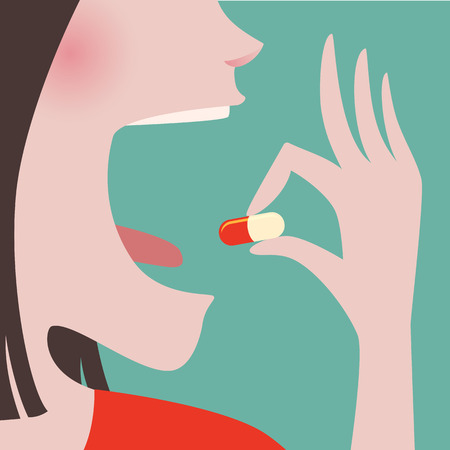 Close up of Woman in red cloth taking a pill in to her mouth