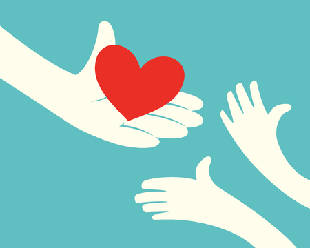 charity: Close up of hand holding red heart and hands of children on green background