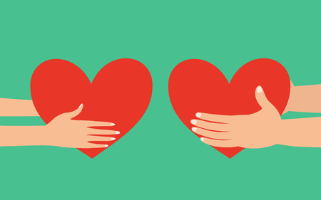 adoration: Male and female hands holding red heart giving to each other