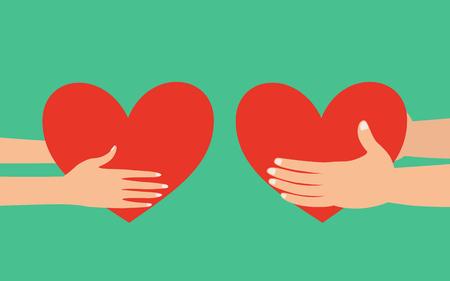 manos masculinas y femeninas que llevan a cabo el corazón rojo dando el uno al otro