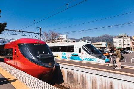 KAWAGUCHIKO,JAPAN 14 MAR 2019 Two Fujisan view express parking at Kawaguchiko Station on a clear blue sky day Editorial