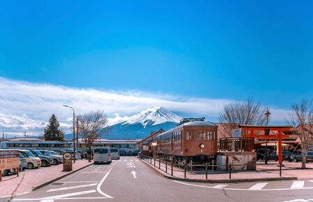 KAWAGUCHIKO,JAPAN 14 MAR 2019 Kawaguchiko station and Train model 1897 display with Mt.Fuji in the background with a lot of car parking at the station