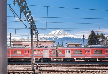 KAWAGUCHIKO,JAPAN 14 MAR 2019 -Mt. Fuji and Red Swiss-Japan Train park at Kawaguchiko Station