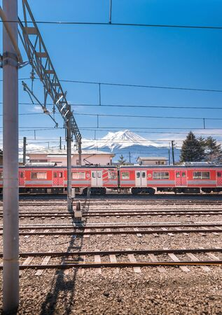 KAWAGUCHIKO,JAPAN 14 MAR 2019 -Red Train and Mt. Fuji background at Kawaguchiko Station Japan