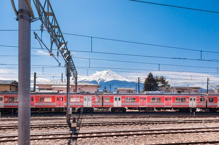 KAWAGUCHIKO,JAPAN 14 MAR 2019 -Red Train park at Kawaguchiko station with Mt. Fuji in the background Editorial