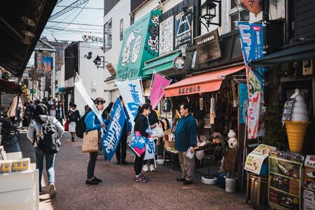 TOKYO,JAPAN 13 MAR 2019 Candidate on election campaign with the local people at Yanaka Ginza, Taito City, Tokyo Editorial