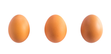 three chicken eggs isolated on white background Фото со стока