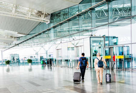 HANOI,VIETNAM 27 OCT 2019 - Traveller walking in front of Departure Hall at the Hanoi International Airport (Noi Bai) Vietnam.
