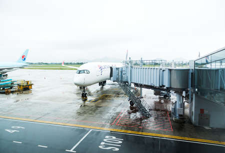 HANOI,VIETNAM 24 OCT 2019- View of an airplane from LATAM Airlines in a rainy day at the Hanoi International Airport (Noi Bai) Vietnam.