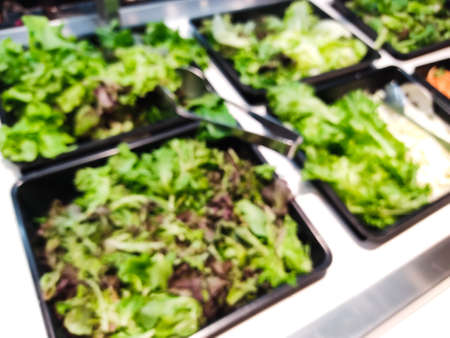 Blurred green salad bar. Healthy eating concept 免版税图像