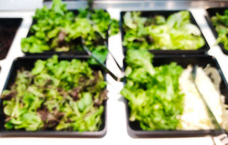 Close up of Blurred green salad bar. Healthy eating concept