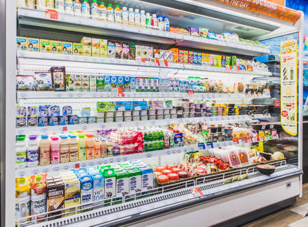HANOI,VIETNAM - March 1,2021 -Variety of Drinking yogurt, soy milk,milk,pudding and healthy drink on Freezer shelves at convenience store