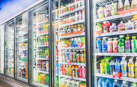 HANOI,VIETNAM - March 1,2021 -Variety of soft drinks,energy drinks,sport drinks,drinking water and fruit juice on Freezer shelves at convenience store Editorial