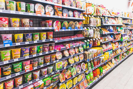 Instant noodles and snack on Supermarket shelves background,snack and noodle cup sale on the shelf in a convenience store. Editorial